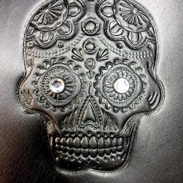 sugar skull embossed heat shield with crystals