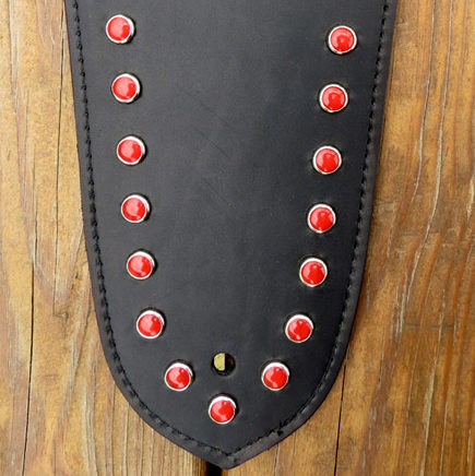 fender bib with red studs