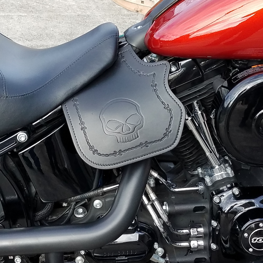 Harley-Davidson heat shield with skull embossing and barb wire tooled border