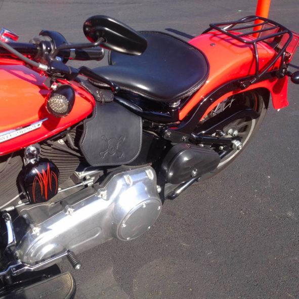 Harley-Davidson heat shield with crossbones embossing