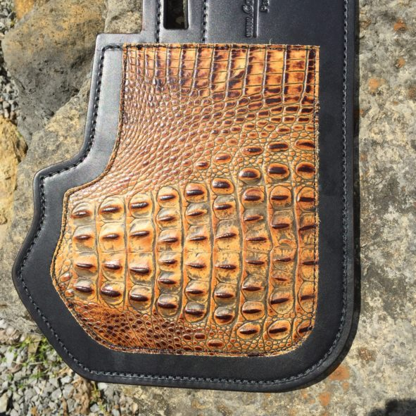 Amber embossed alligator leather on Harley heat deflector