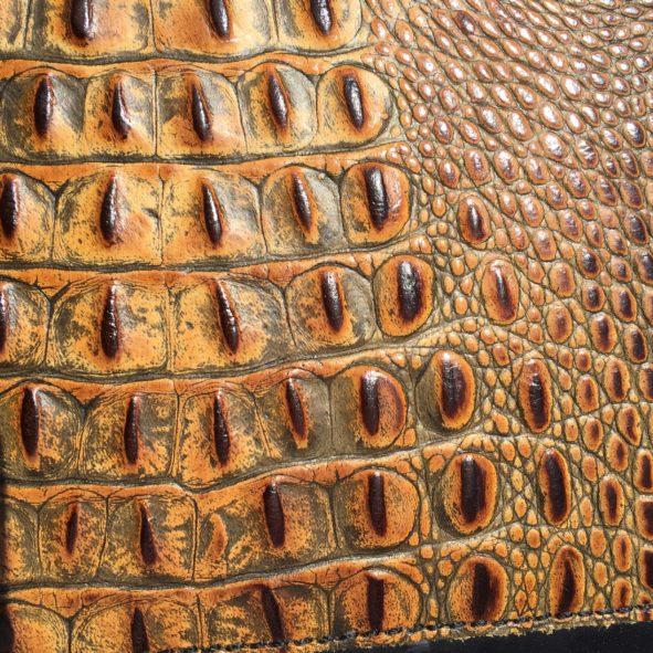 Amber embossed alligator leather on Harley heat deflector