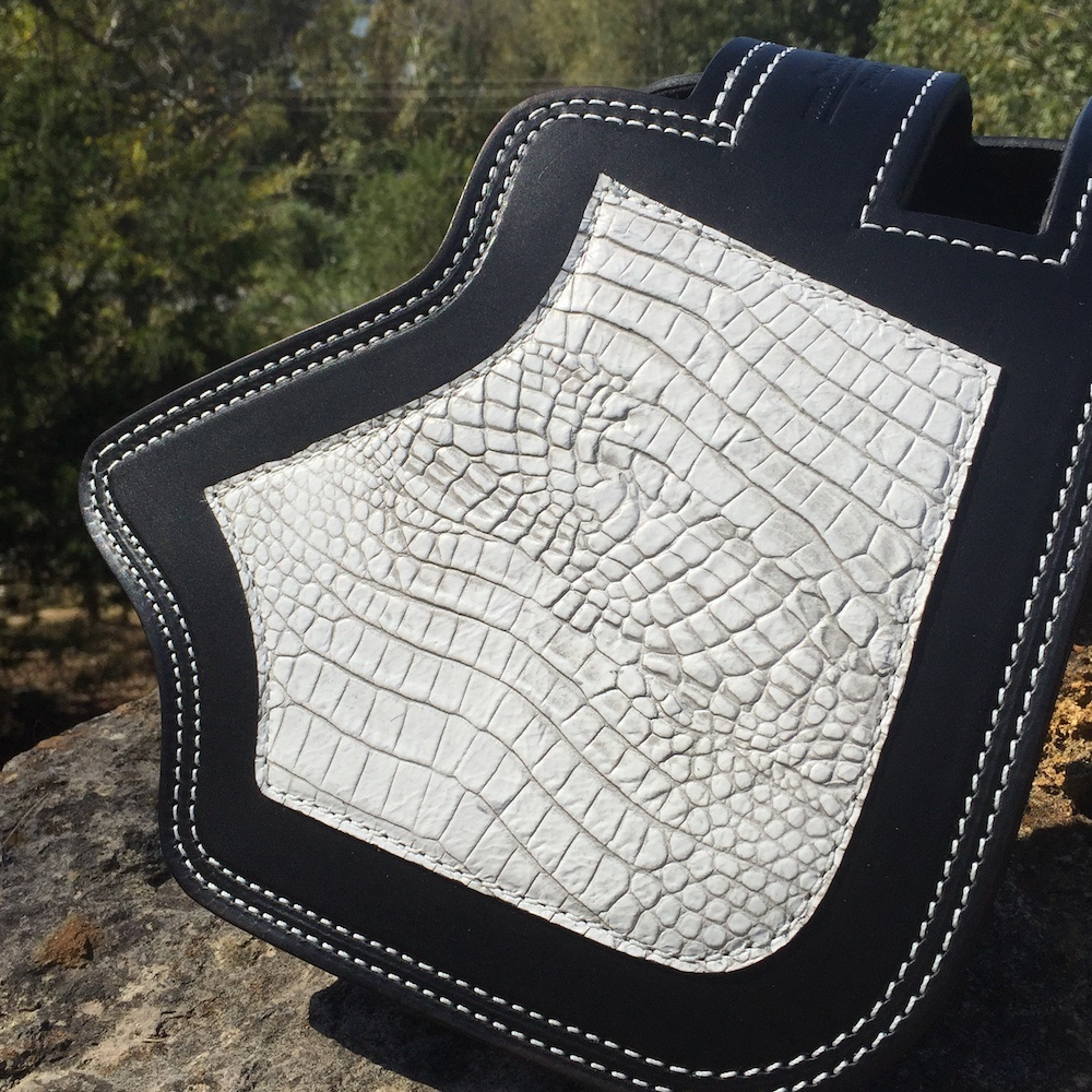 Indian heat shield with antique white alligator embossed leather overlay from Captain Itch