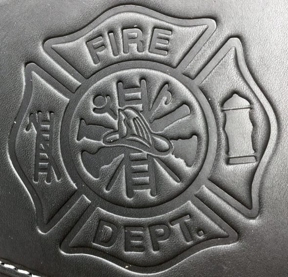 Harley heat shield with firefighter emblem embossing