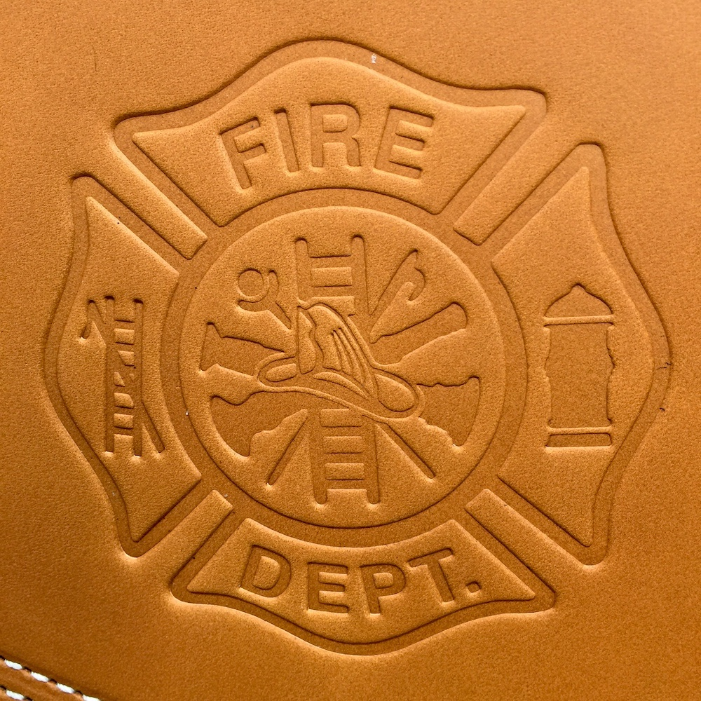 Indian heat shield with firefighter emblem embossing