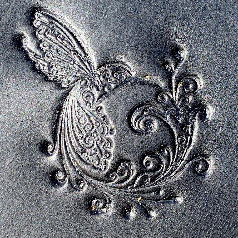 motorcycle leather heat shield with Hummingbird embossing